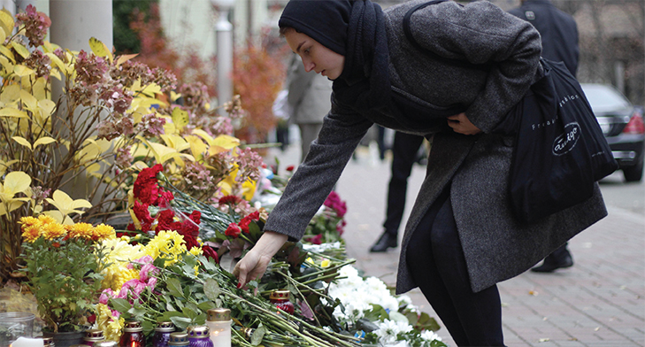 A woman in black dress paying her tributes to terror victims in Ottawa, Canada.